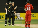 George Bailey and Cameron White of Australia celebrate their win during game two of the International Twenty20 series between Australia and England at the Melbourne Cricket Ground on January 31, 2014
