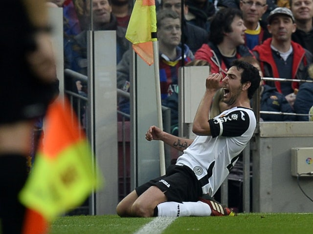 Valencia's midfielder Daniel Parejo celebrates after scoring the equalizer during the Spanish league football match FC Barcelona vs Valencia CF at the Camp Nou stadium in Barcelona on February 1, 2014