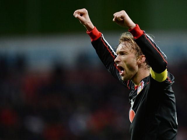Bayer Leverkusen's midfielder Simon Rolfes reacts after the German first division Bundesliga football match Bayer Leverkusen vs VfB Stuttgart in Leverkusen, western Germany on February 1, 2014