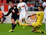 Leverkusen's striker Stefan Kiessling and Stuttgart's goalkeeper Sven Ulreich vie for the ball during the German first division Bundesliga football match Bayer Leverkusen vs VfB Stuttgart in Leverkusen, western Germany on February 1, 2014