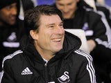 Swansea City's Danish manager Michael Laudrup gestures during the English FA Cup fourth round football match between Birmingham City and Swansea City at St Andrew's stadium in Birmingham on January 25, 2014