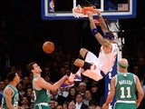 New York Knicks Kenyon Martin smashes the ball against Boston Celtics players during an NBA game at Madison Square Garden in New York, January 28, 2014