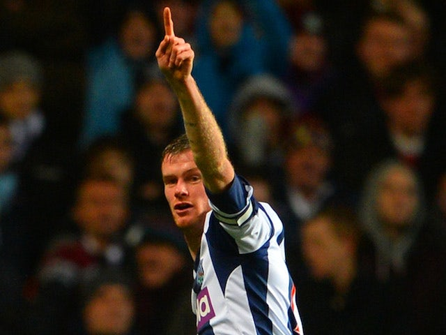 Chris Brunt of West Brom celebrates scoring the opening goal during the Barclays Premier League match against Aston Villa on January 29, 2014