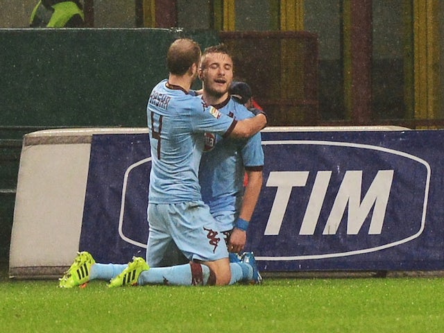 Torino's forward Ciro Immobile celebrates after scoring a goal with teammate Swiss midfielder Migjen Basha during the Serie A football match against AC Milan on February 1, 2014