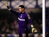 Oldham keeper Dean Bouzanis in action during the FA Cup Fifth Round Replay between Everton and Oldham Athletic at Goodison Park on February 26, 2013