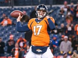 Quarterback Brock Osweiler #17 of the Denver Broncos throws a pass as he warms up before a game against the San Diego Chargers at Sports Authority Field Field at Mile High on December 12, 2013