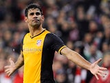 Atletico Madrid's Diego Costa celebrates after scoring his team's second goal against Athletic Bilbao during their Copa del Rey match on January 29, 2014