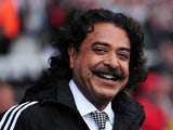 Fulham's Pakistani-born US owner Shahid Khan smiles before the English Premier League football match between Fulham and Arsenal at Craven Cottage in London on August 24, 2013