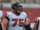 Garrett Reynolds #75 of the Atlanta Falcons warms up before play against the Tampa Bay Buccaneers on November 17, 2013