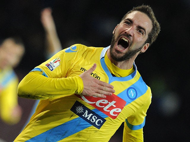 Napoli's Gonzalo Higuain celebrates after scoring the opening goal against Lazio during their Coppa Italia match on January 29, 2014