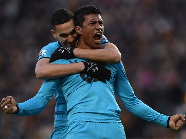 Paulinho of Tottenham Hotspur celebrates scoring a goal during the Barclays Premier League match between Hull City and Tottenham Hotspur at KC Stadium on February 1, 2014