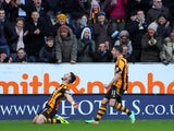 Shane Long of Hull City celebrates his debut goal with team-mate Robbie Brady during the Barclays Premier League match between Hull City and Tottenham Hotspur at KC Stadium on February 01, 2014