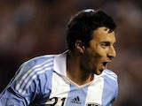 Argentina's forward Ignacio Scocco celebrates after scoring against Brazil during the Americas' Super Derby football match at La Bombonera stadium in Buenos Aires on November 21, 2012