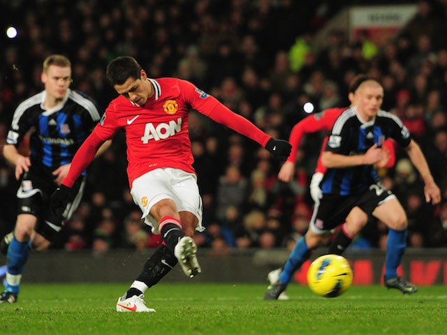 Javier Hernandez of Manchester United scores a goal during the Barclays Premier League match between Manchester United and Stoke City at Old Trafford on January 31, 2012