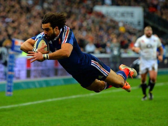 Jean Marc Doussain of France goes over to score their second try during the RBS Six Nations match between France and England at Stade de France on February 1, 2014