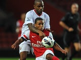 Jason Puncheon of Southampton and Jernade Meade of Arsenal during the Markus Liebherr Memorial Cup match between Southampton and Arsenal at St Mary's Stadium on July 14, 2012