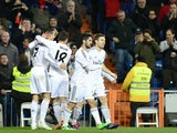 Real's Jese Rodriguez Ruiz celebrates with teammates after scoring the opening goal against Espanyol during their Copa del Rey quarter-final match on January 28, 2014