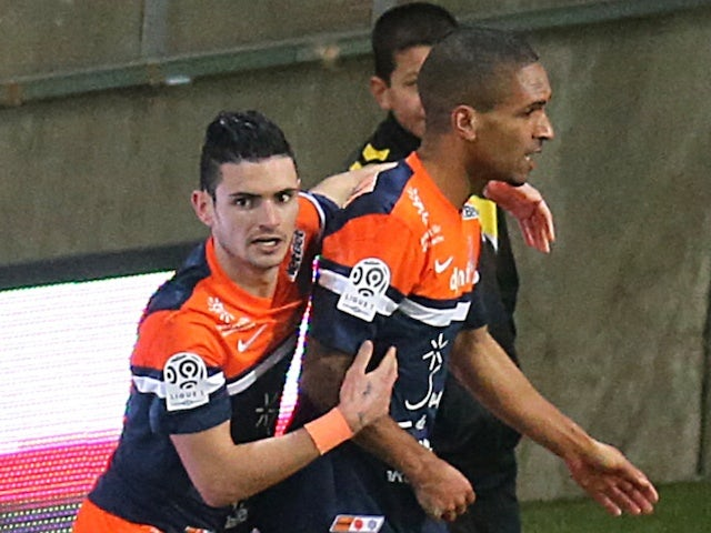 Montpellier's French midfielder Joris Marveaux (R) is congratulated by teammate French midfielder Remy Cabella (L) after scoring a goal during the French L1 football match against Reims on February 1, 2014