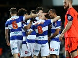 QPR's Karl Henry celebrates with teammates after scoring his team's second goal against Bolton during their Championship match on January 28, 2014