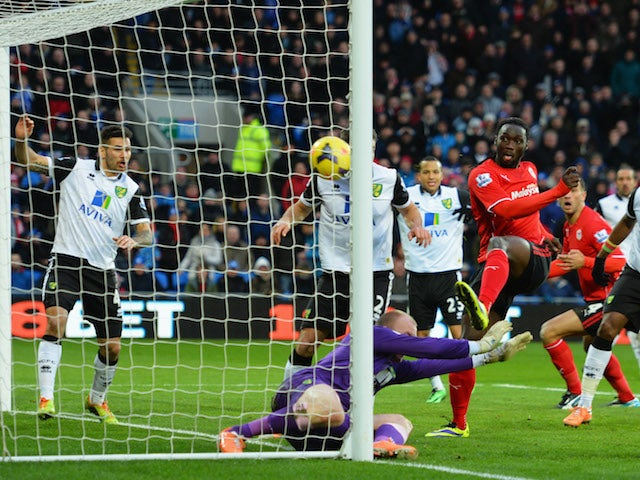 Kenwyne Jones of Cardiff City beats goalkeeper John Ruddy of Norwich City to score their second goal during the Barclays Premier League match on February 1, 2014