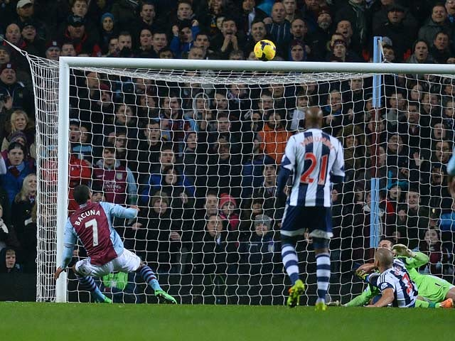 Aston Villa's Leandro Bacuna scores his team's second goal against West Brom during their Premier League match on January 29, 2014