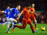 Luis Suarez of Liverpoolis pursued by James McCarthy of Everton during the Barclays Premier League match between Liverpool and Everton at Anfield on January 28, 2014