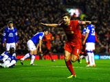 Steven Gerrard of Liverpool celebrates after scoring the opening goal during the Barclays Premier League match between Liverpool and Everton at Anfield on January 28, 2014