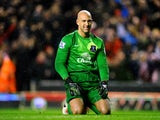 Dejected goalkeeper Tim Howard of Everton looks on during the Barclays Premier League match between Liverpool and Everton at Anfield on January 28, 2014