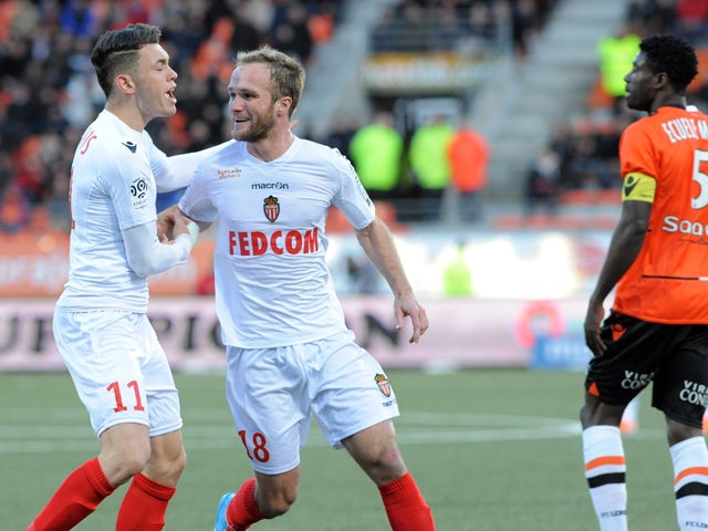 Monaco's France forward Valere Germain is congratulated by his teammate Argentinian midfielder Lucas Ocampos (L) after Germain scored an equalizer during the French L1 football match Lorient vs Monaco on February 1, 2014