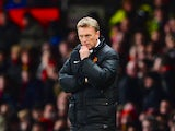 Manchester United Manager David Moyes looks on during the Barclays Premier League match between Manchester United and Cardiff City at Old Trafford on January 28, 2014