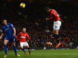 Robin van Persie of Manchester United scores the opening goal during the Barclays Premier League match between Manchester United and Cardiff City at Old Trafford on January 28, 2014