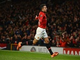 Robin van Persie of Manchester United celebrates scoring the opening goal during the Barclays Premier League match between Manchester United and Cardiff City at Old Trafford on January 28, 2014