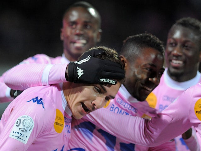 Evian's Argentinian forward Marco Ruben is congratulated by teammates after scoring during their French L1 football match against Ajaccio on February 1, 2014