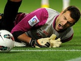 Racing Santander's goalkeeper Mario Fernandez grimaces during the Spanish league football match Malaga CF vs Real Racing Club de Santander on April 9, 2012