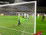 Mauricio Pinilla (R) of Cagliari scores the opening goal during the Serie A match between Cagliari Calcio and ACF Fiorentina at Stadio Sant'Elia on February 1, 2014