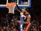 Miami Heat LeBron James slams the ball against the New York Knicks during their NBA game February 1, 2014
