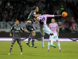 Evian's Senegalese forward Modou Sougou vies with Ajaccio's French defender Laurent Bonnart during their French L1 football match on February 1, 2014