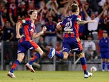 Adam Taggart and Craig Goodwin of the Jets celebrate a goal during the round 17 A-League match between Newcastle Jets and the Western Sydney Wanderers at Hunter Stadium on February 1, 2014