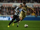 Sylvain Marveaux of Newcastle United evades Alex Mowatt of Leeds United during the Capital One Cup Third Round match between Newcastle United and Leeds United at St James' Park on September 25, 2013