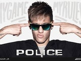 Brazilian football player Neymar poses in Police sunglasses as part of their new 2014 eyewear campaign