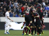 Nice's players celebrate after scoring during the French L1 football match Nice (OGC Nice) vs Lille (LOSC) on February 2, 2014