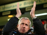 Alan Pardew manager of Newcastle United applauds the fans during the Barclays Premier League match between Norwich City and Newcastle United at Carrow Road on January 28, 2014