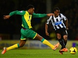 Leroy Fer of Norwich City and Vurnon Anita of Newcastle United battle for the ball during the Barclays Premier League match between Norwich City and Newcastle United at Carrow Road on January 28, 2014