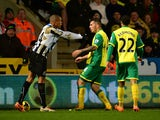 Loic Remy of Newcastle United and Bradley Johnson of Norwich City come to blows during the Barclays Premier League match between Norwich City and Newcastle United at Carrow Road on January 28, 2014
