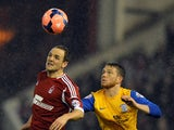 Nottingham Forest's Welsh midfielder David Vaughan and Preston North End's English forward Joe Garner compete for the ball during the English FA Cup fourth round match between Nottingham Forest and Preston North End at City Ground in Nottingham on January