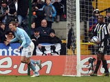 Manchester City's Edin Dzeko celebrates after scoring against Notts County during their English FA Cup football match at Meadow Lane in Nottingham, central England, on January 30, 2011