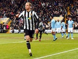 Notts County's English midfielder Neal Bishop celebrates after scoring the opening goal against Manchester City during their English FA Cup football match at Meadow Lane in Nottingham, central England, on January 30, 2011