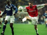Oleg Luzhny attempts to win possession from Kevin Campbell on November 18, 2000.