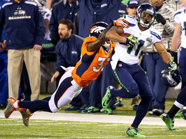 Wide receiver Percy Harvin #11 of the Seattle Seahawks runs the ball against strong safety Duke Ihenacho #33 of the Denver Broncos  on February 2, 2014