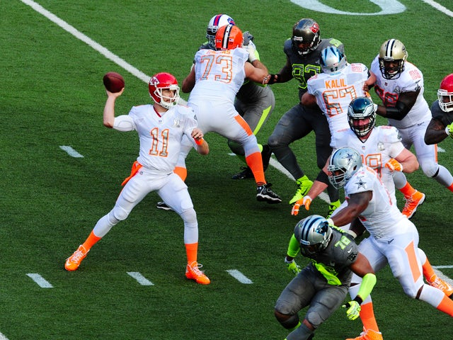 Alex Smith #11 of the Kansas City Chiefs and Team Rice passes against Team Sanders during the 2014 Pro Bowl at Aloha Stadium on January 26, 2014